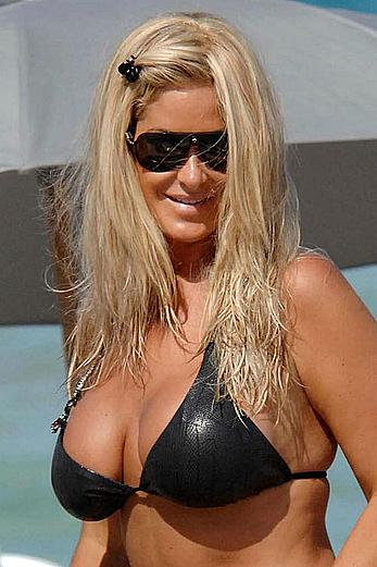 Kim Zolciak deep cleavage in black bikini