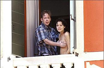 Lily Allen topless on a balcony