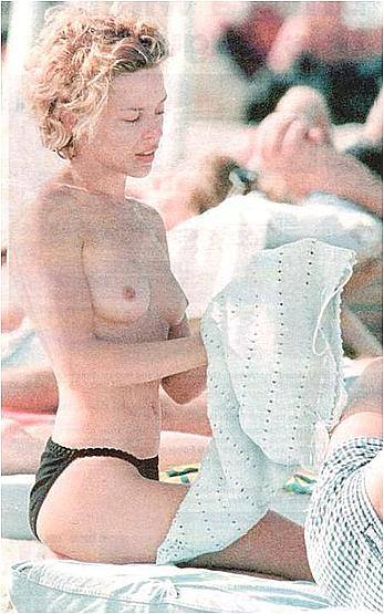 Kylie Minogue caught topless on a beach