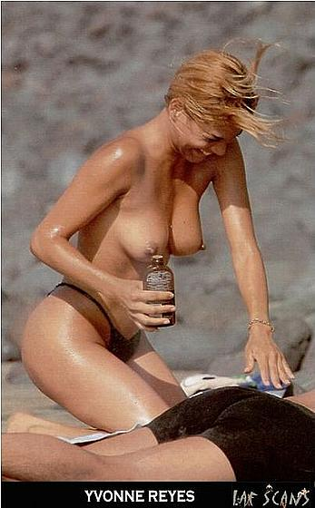 Yvonne Reyes sunbathing topless on a beach