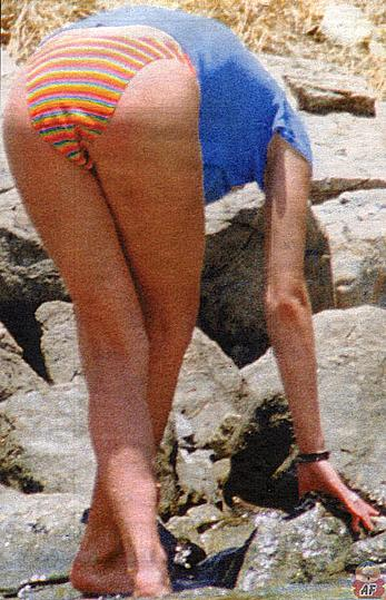 Zoe Ball caught topless on the beach