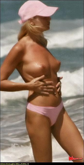 Stefania Orlando sunbathing topless