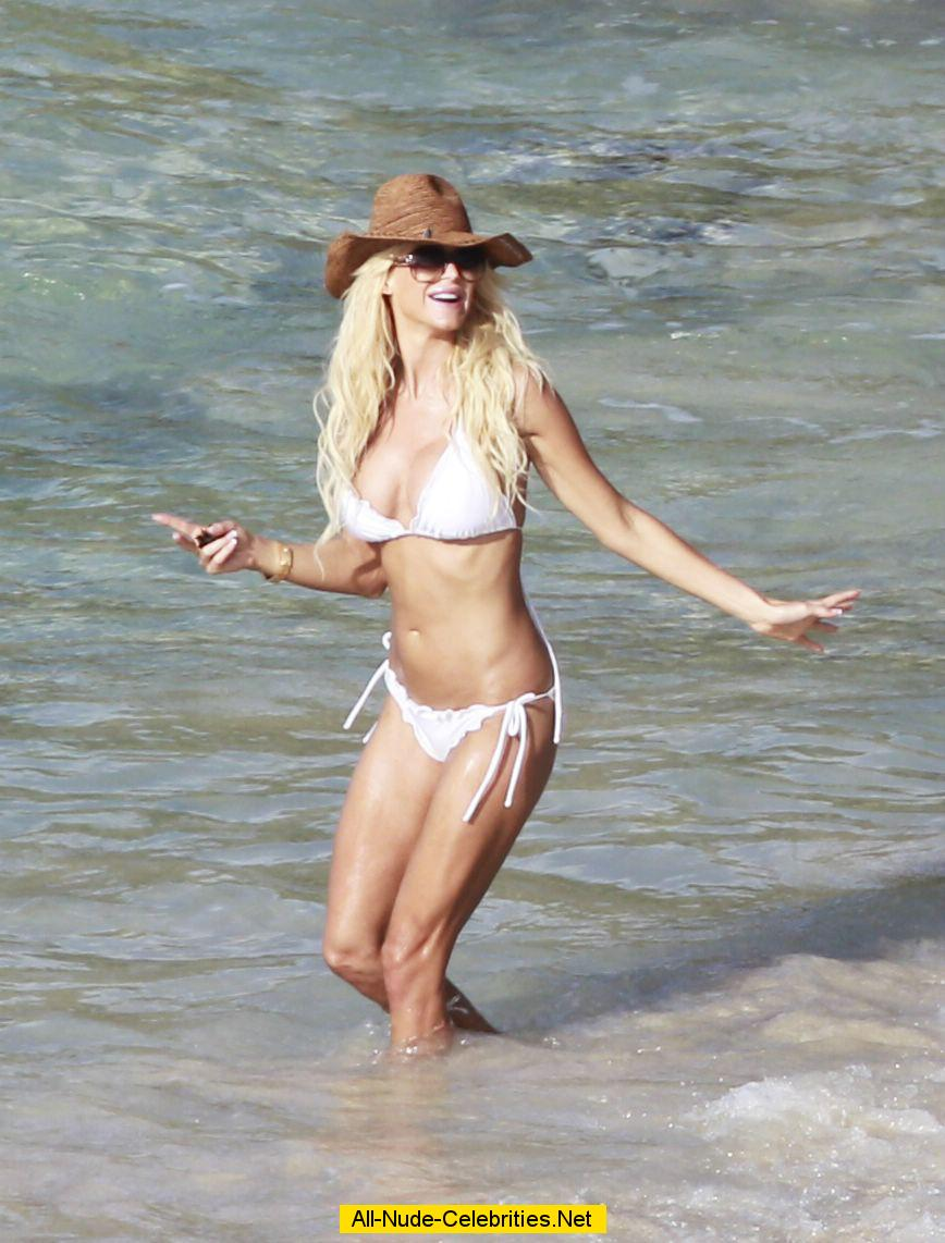 Victoria Silvstedt caught in white bikini on the beach